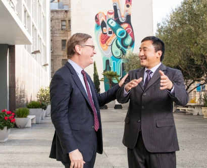 UCSF Chancellor Sam Hawgood and UC Hasting Chancellor Frank Wu talk at the site of a new joint campus housing development