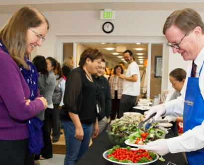 Chancellor Sam Hawgood serves lunch to a UCSF staff member during a Laurel Heights staff appreciation event