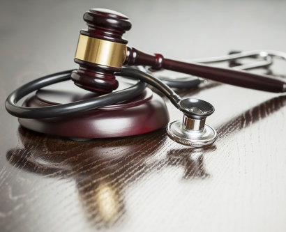 A stock image of a gavel and a stethoscope