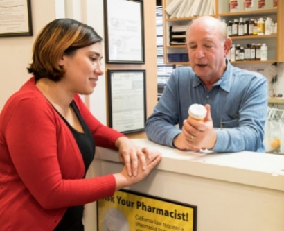 Psychiatric/mental health nurse practitioner Jamie Sanders consults with pharmacist Lester Bornheim at Marin Community Clinics