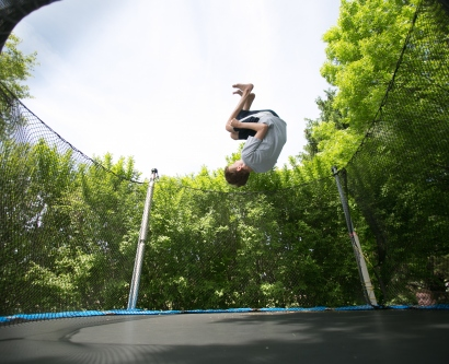Joshua Osborn does a backflip on the trampoline in the backyard of his home in Cottage Grove, Wisconsin.
