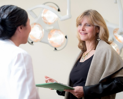 Laura Esserman talks with colleague Jo Chien in a clinic exam room at the UCSF Carol Franc Buck Breast Care Center.