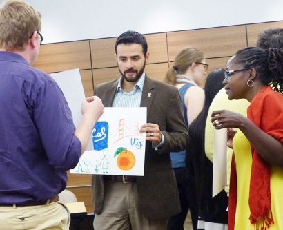 Three people participate in an activity at the Minority Training Program in Cancer Control Research Summer Institute