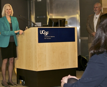 Stephanie Marrus presents at an NIH event devoted to help life science entrepreneurs commercialize their technology as Steve Blank, architect of the Lean LaunchPad framework, looks on.
