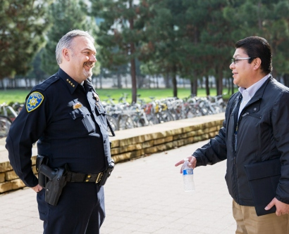 Police Chief Mike Denson chats with a UCSF community member on the Mission Bay campus