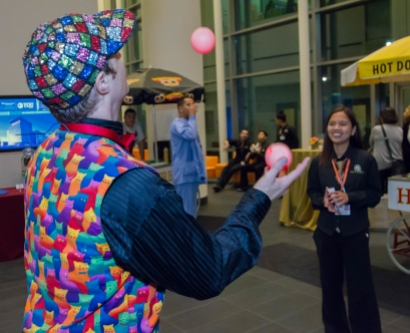 A juggler entertains employees at UCSF Medical Center at Mission Bay