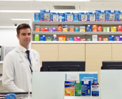 Steve Simon standing behind the counter at the new Walgreens in Mission Hall