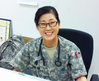 Misun Moser smiles for a photo in her Army fatigues
