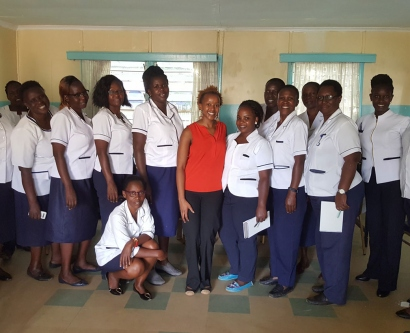 Dr. Mungo standing with nurses