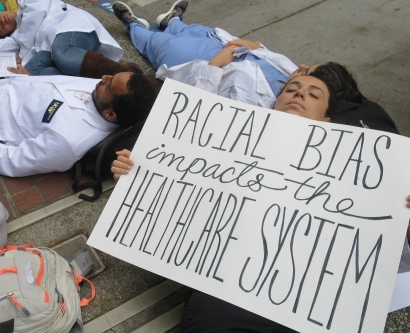 "UCSF students participate in a ""die-in"" in front of the Parnassus Library"