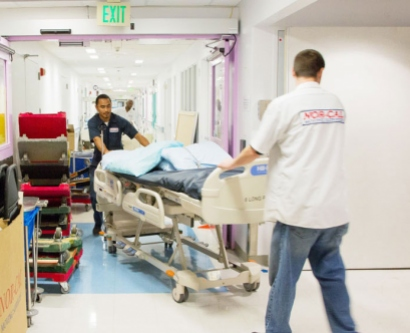Movers work to clean out a vacated floor at the Parnassus hospital.