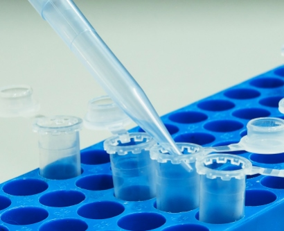 A stock image shows a pipette tip filling in an eppendorf tube