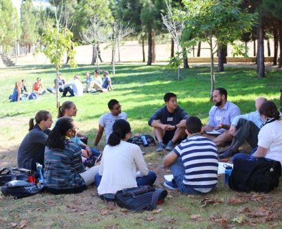 School of Medicine students have break-out groups on the lawn during their orientation