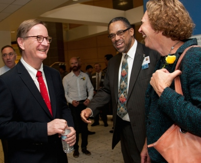 Chancellor Sam Hawgood, MBBS, shares a laugh with Andre Campbell, MD, and Elizabeth Ozer, PhD