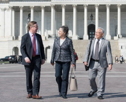 UCSF Chancellor Sam Hawgood, Vice Chancellor for University Relations Barbara J. French and Vice Chancellor for Science Policy and Strategy Keith Yamamoto walk in front of the U.S. Capitol in Washington, D.C.