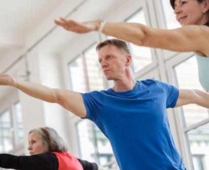 Stock image of seniors in yoga class