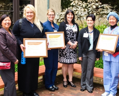 UCSF Sustainability Award winners pose with their framed certificates