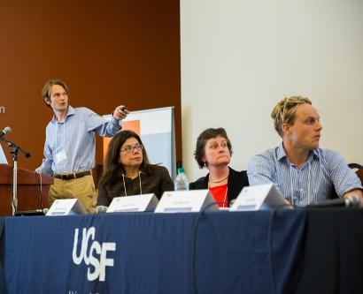 Alex Pollen, a postdoctoral scholar at UCSF, speaks during a Zika symposium.