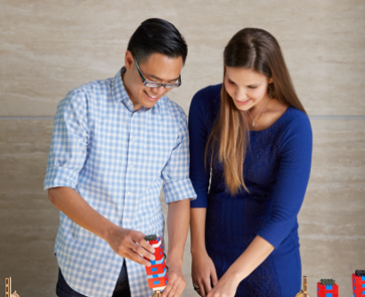 Harrison Liu and Veronica Pessino building LEGOs