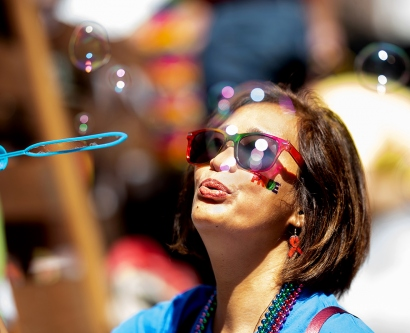 Woman blows bubbles at 2018 SF Pride Parade