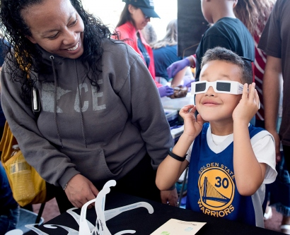 a child looks through 3D glasses