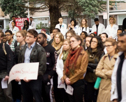 About 100 people gathered for the Dec. 10 White Coats for Black Lives demonstration