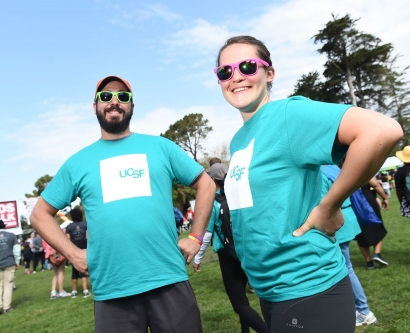 2 UCSF community members pose for a photo at AIDS Walk San Francisco