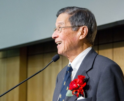 Y.W. Kan at the podium during the annual Institute for Human Genetics symposium, held this year in his honor