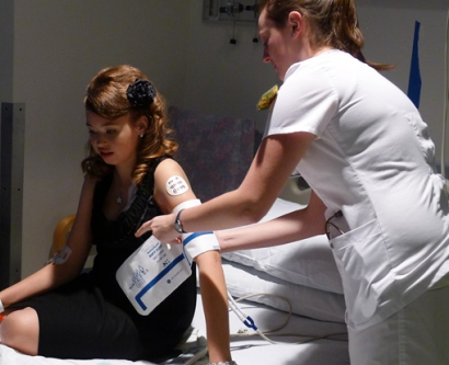 Adella Clark, 16, a kidney transplant patient at UCSF Benioff Children's Hospital, gets her blood pressure checked before she goes downstairs to the prom.