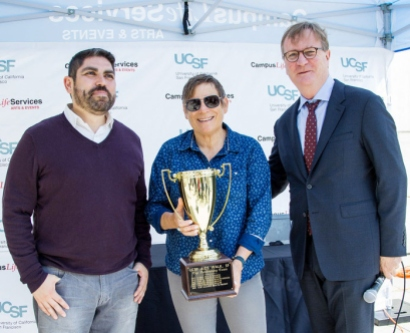 UCSF top fundraisers for AIDS Walk 2015 receive a trophy from Chancellor Sam Hawgood