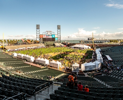 People mill around on the field of AT&T Park during the 2014 Discovery Days event