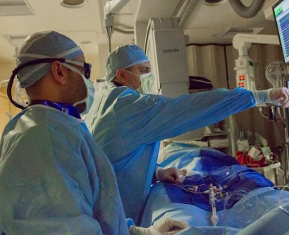 Drs. Liviu Klein and Mandar Aras do surgery on a patient to implant a sensor to monitor his heart health.