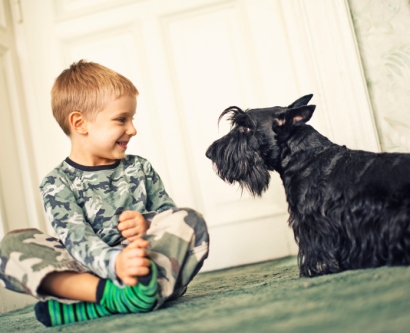 Child with dog inside home