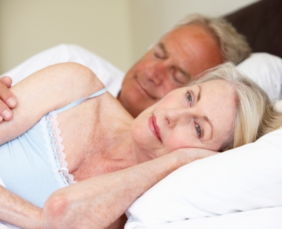Stock photo of woman having trouble sleeping