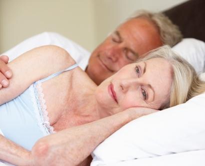 Stock photo of woman having trouble sleeping