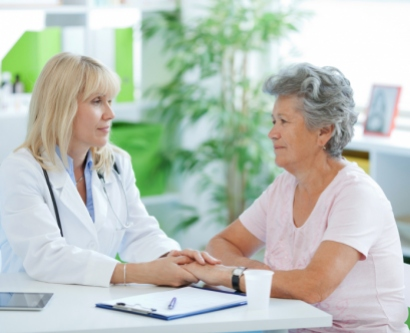 Stock image of doctor comforting an elderly patient