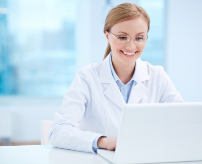 Stock image of scientist at computer