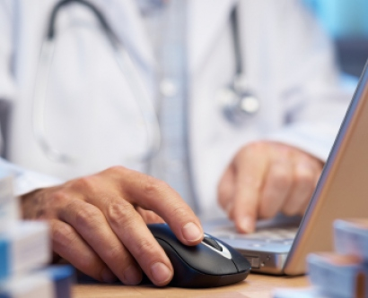 Stock image of doctor using computer
