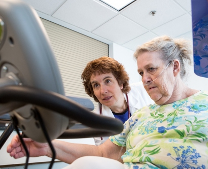 UCSF School of Nursing professor DorAnne Donesky works with a patient, teaching her to exercise safely without overtaxing her lungs