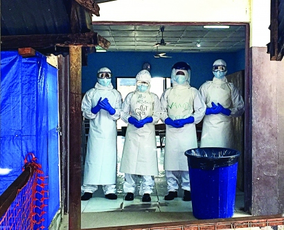 Volunteers in an Ebola isolation unit