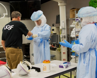 UCSF employees learn how to properly wear personal protective gear required to treat Ebola patients
