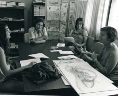 Historic image of students and faculty engaging in early midwifery teaching in the 1970s