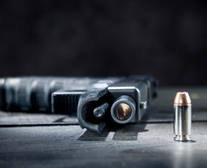 handgun and bullet on a table
