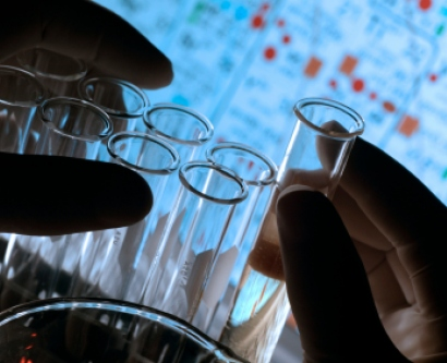 Stock image of hands holding test tubes in the lab