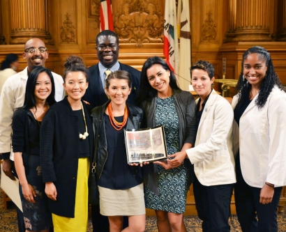 UCSF student leaders of the national White Coats for Black Lives movement pose for a group photo after receiving an award at City Hall
