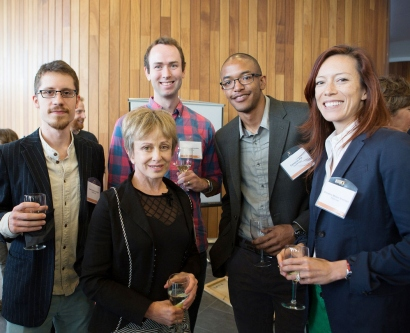 UCSF Discovery Fellows pose for a group photo with Harriet Heyman at a reception
