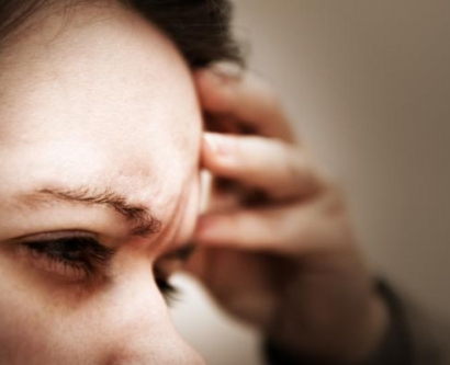 Stock image of woman with migraine