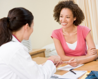 Stock image of young woman at doctor's office