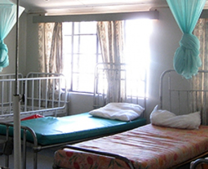 mosquito nets hang over beds in Africa