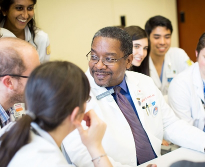 Talmadge King speaks in a meeting with chief residents